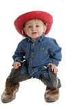 These boots are made for walking. Little cowboy having trouble standing in his dad's boots Stock Images
