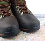 Boots and map Royalty Free Stock Image