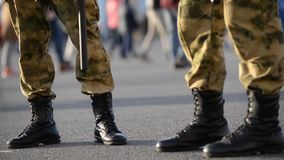 Boots of military soldiers, the military is discussing something and marking time.