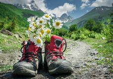 Boots and mountains landscape Stock Photography