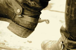 Boots 'n spurs. Detail old cowboy boots and spurs royalty free stock photography