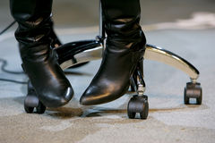 Boots and office chair Royalty Free Stock Images