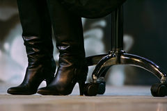 Boots and office chair Royalty Free Stock Image