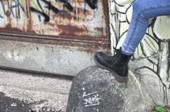 Boots. Over a stone in suburban Stock Photography