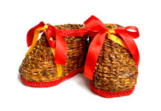 Boots2. A pair of handmade weaving boots with red ribbon Royalty Free Stock Photos