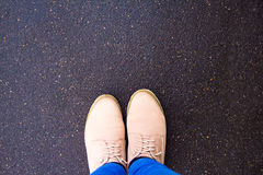 Boots on the pavement, top view stock photography