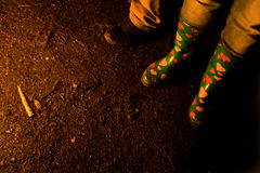 Boots of People Around Bonfire Stock Photos