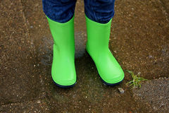 Boots in a puddle. At rainy day Stock Image