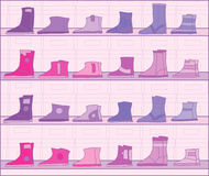 Boots on racks. Stock Photo