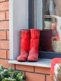 Boots red on a window sill design a vintage Stock Photo