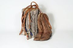 Boots & Reins. Cowboy's  boots and reins on a white background Royalty Free Stock Image