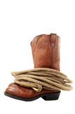 Boots & Rope. Western boots and rope isolated on white stock photo