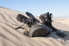 Boots in sand Stock Photo