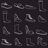 Boots and shoes white outline icons set Royalty Free Stock Photo