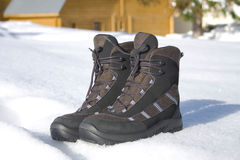 Boots on snow. Two boots for active rest stand on to snow Stock Image
