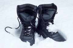 Boots in the snow Royalty Free Stock Image