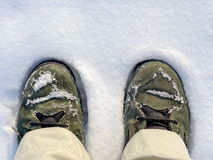 Boots in snow Stock Photography