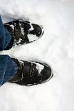 Boots in snow Stock Photos