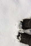 Boots in the snow. Black Boots in the snow Royalty Free Stock Photography