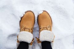 Boots in snow Royalty Free Stock Photos