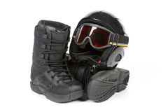 Boots for snowboarding and a protective helmet Royalty Free Stock Images