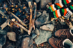 Boots and socks drying near campfire Stock Images
