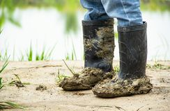 Boots soiled filled with soil densely. Stock Photo