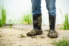 Boots soiled filled with soil densely. Royalty Free Stock Image