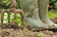 Boots and spade Stock Photos