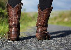 Boots standing on road in countryside Stock Image