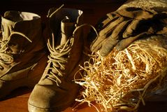 Boots, straw and Gloves Royalty Free Stock Photography