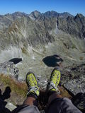 Boots in Tatras rocky peaks and green valley of Tatra mountains in Slovak Stock Images