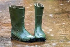 Boots in thе rain Stock Photo