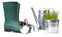 Boots with tool and watering Stock Photography