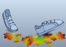 Boots traveling on autumn leves Royalty Free Stock Images