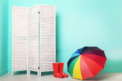 Boots with umbrella Royalty Free Stock Photo