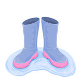 Boots in water Royalty Free Stock Image