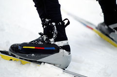 These Boots were made for Skiiing. It's all about timing when skate skiing up hill. Close up of nordic skating boots, bindings and skis in the snow Stock Photos