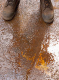Boots on Wet Rusty Ground Stock Image