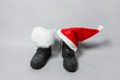 Boots with white felt and christmas hat Stock Images