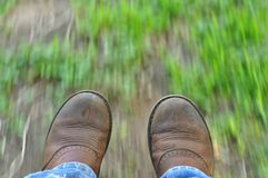 Boots. Work boots on the move in motion Royalty Free Stock Image