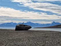 Spitsbergen, Svalbard. Old Boat Wreck at the Coast of Spitsbergen, Svalbard royalty free stock images