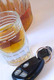 Booze. A shot of whiskey and car keys stock images
