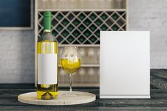 Booze concept. Close up of white wine glass and bottle with empty label and banner on bar counter. Blurry interior in the background. Booze concept. Mock up, 3D Royalty Free Stock Photography