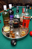 Booze on a pool table Royalty Free Stock Images