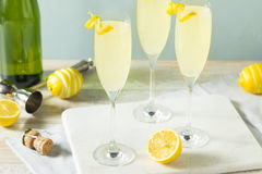 Boozy Bubbly Lemon French 75 Cocktail. With Champagne royalty free stock image