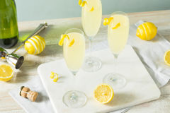 Boozy Bubbly Lemon French 75 Cocktail. With Champagne stock photography