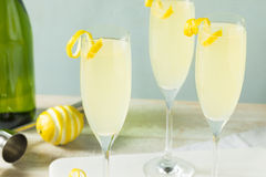 Boozy Bubbly Lemon French 75 Cocktail. With Champagne stock images