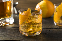 Boozy Homemade Old Fashioned Bourbon on the Rocks Royalty Free Stock Photo