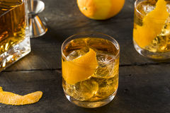 Boozy Homemade Old Fashioned Bourbon on the Rocks. With an Orange Garnish stock photo